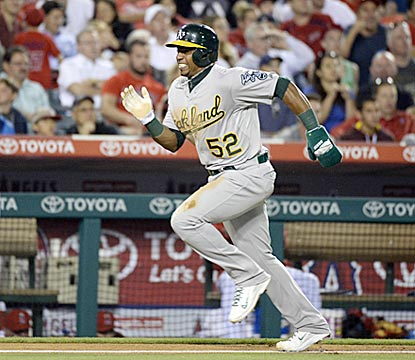 Yoenis Cespedes, who has an adventurous series on defense, races home and scores in the sixth inning.  (USATSI)