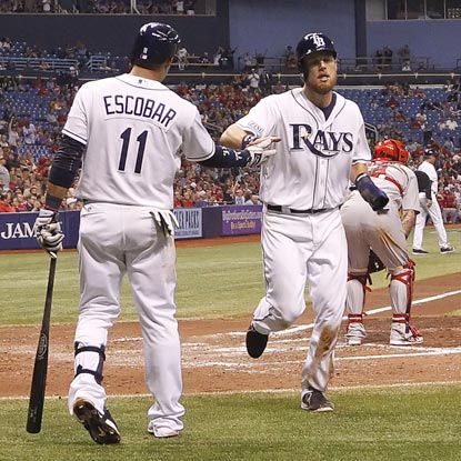 Yunel Escobar greets Ben Zobrist after he scores on Tampa Bay's first scoring hit in four days.  (USATSI)