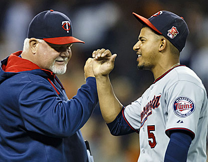 Ron Gardenhire, Eduardo Escobar and the Twins close to within three games of the Tigers with a win over Detroit. (USATSI)