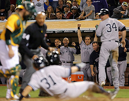 Ichiro slides home safely for a run as the Yankees bench celebrates in New York's shutout win over the A's. (USATSI)