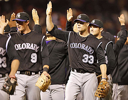 Justin Morneau and the Rockies pull off a ninth-inning comeback with five runs to beat the Giants. (USATSI)