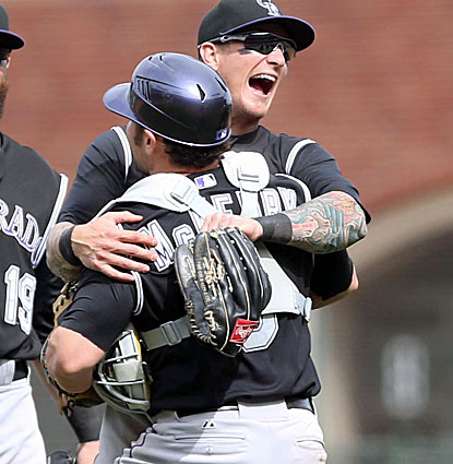 Brandon Barnes celebrates with catcher Michael McKenry after the Rockies rally to take down the first-place Giants. (USATSI)