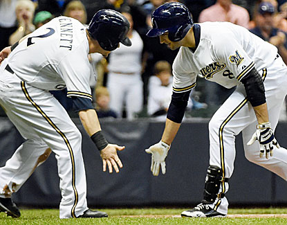 Ryan Braun celebrates with Scooter Gennett after hitting a two-run home run in the eighth inning (USATSI)