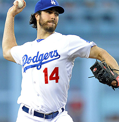Dan Haren pitches into the seventh inning and hits a tiebreaking three-run double for the Dodgers. (Getty Images)