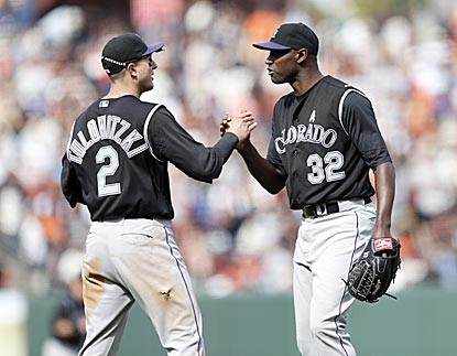 LaTroy Hawkins (right) saves all three games of a series in which Colorado dominates San Francisco in the late innings.  (USATSI)
