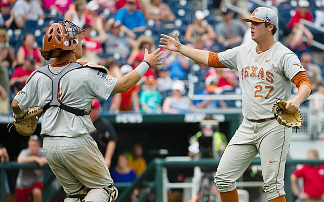Travis Duke (right) earns congratulations from Tres Barrera after closing out the Longhorns' victory. (USATSI)