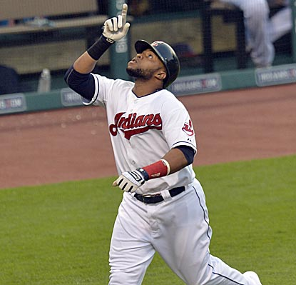 Indians catcher Carlos Santana is thankful for the home run he hits to lead off the bottom of the fourth inning.  (USATSI)