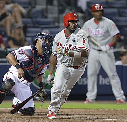 Ryan Howard drives in the go-ahead run in the 13th inning with a grounder that's misplayed by Freddie Freeman.  (Getty Images)