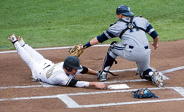 Vanderbilt's Bryan Reynolds slides safely around Jerry McClanahan's tag. (USATSI)
