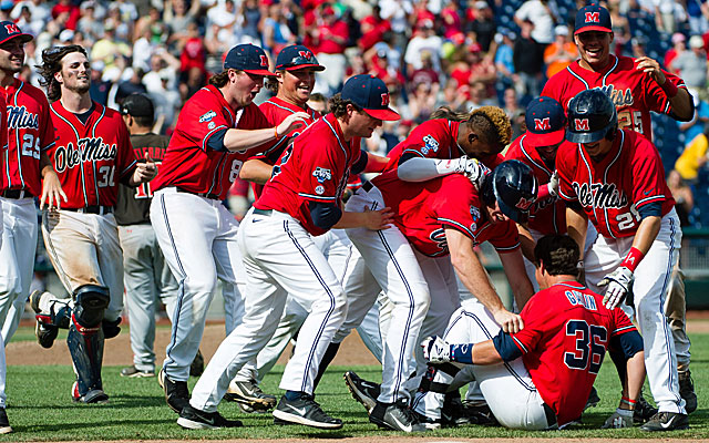 John Gatlin is at the bottom of the pile after knocking in the winning run for Ole Miss. (USATSI)