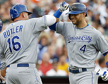 Kansas City's Billy Butler congratulates Alex Gordon after Gordon's two-run homer as the Royals take over 1st place. (USATSI)