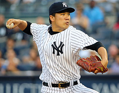 Yankees starter Masahiro Tanaka gets his league-leading 11th win by shutting down the Blue Jays. (USATSI)