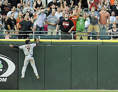 Gordon Beckham's home run sails over the head of Giants outfielder Gregor Blanco in an 8-2 White Sox win. (USATSI)