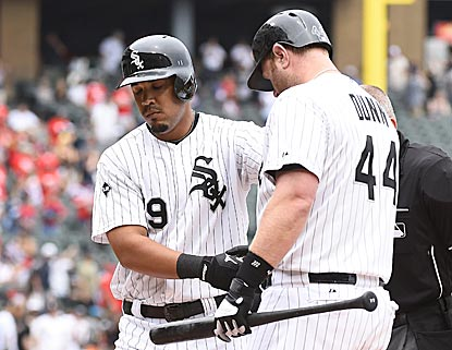 Jose Abreu (left) keeps on crushing, and Adam Dunn adds another home run to foil the reeling Giants.  (USATSI)