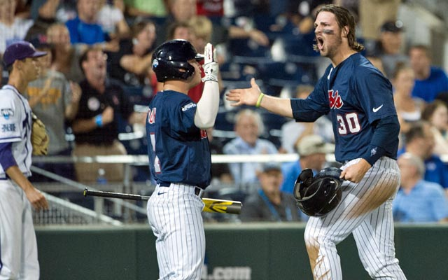 Ole Miss' Will Allen (right) is pumped after batting 3 for 5 with three RBI against TCU. (USATSI)