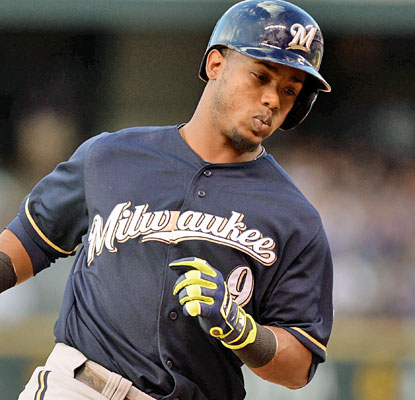 Jean Segura homers twice as the Brewers power past the Rockies in a high-scoring affair at Coors Field.  (USATSI)
