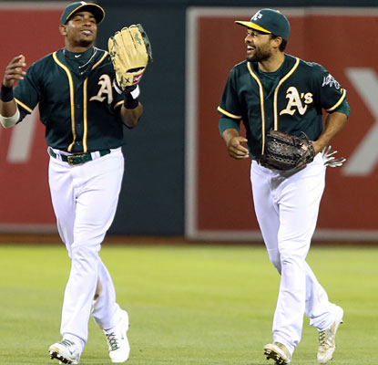 Coco Crisp knocks home the winning run with an eighth-inning single as the A's get past the Red Sox.  (USATSI)