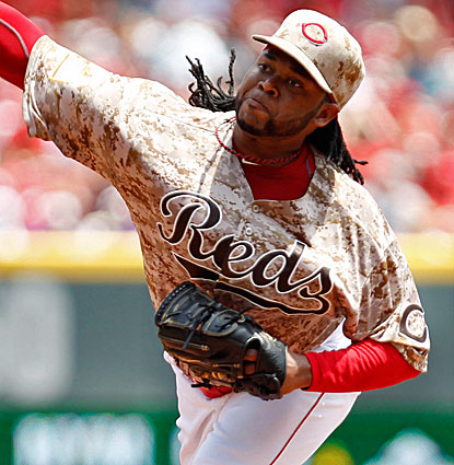 Johnny Cueto pitches eight innings for the Reds and lowers his ERA to 1.86, tops in the National League. (USATSI)