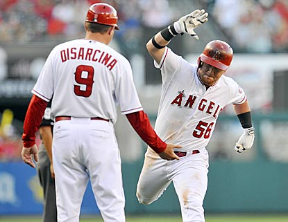 Kole Calhoun seems rather enthused about hitting a home run off Yu Darvish that pushes the Angels' lead to 5-0.  (USATSI)