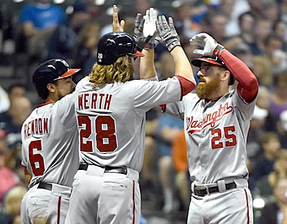 Anthony Rendon and Jayson Werth greet Adam LaRoche after they all score on LaRoche's home run in the third inning.  (USATSI)