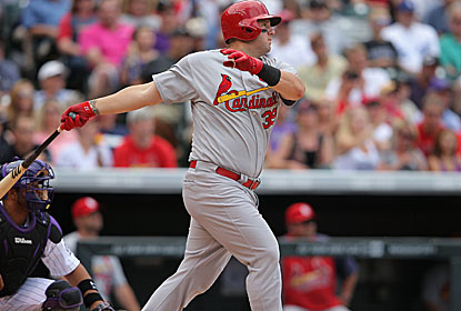 Matt Adams drives in two for St. Louis in a game that features major-league debuts of both starting pitchers. (Getty Images)