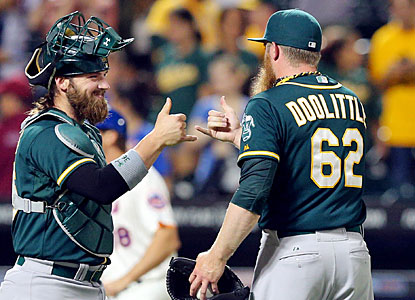 Catcher Derek Norris and closer Sean Doolittle are all smiles after putting away the Mets with a flawless ninth. (USATSI)