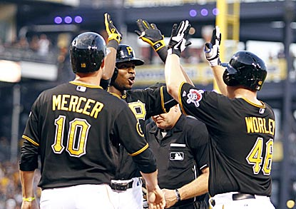 Jordy Mercer (left) and starting pitcher Vance Worley greet Gregory Polanco after his decisive three-run blast.  (Getty Images)