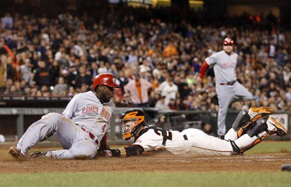 Brandon Phillips has three hits, including a home run and double, but gets tagged out trying to score in the eighth. (USATSI)