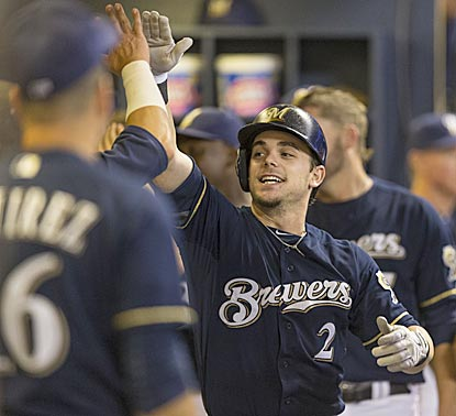 Scooter Gennett celebrates with Brewers teammates after hitting a two-run homer in the eighth inning.  (Getty Images)