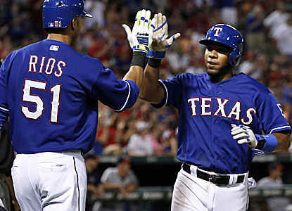 Elvis Andrus is congratulated after scoring a run in the Rangers' victory over the visiting Twins.  (USATSI)