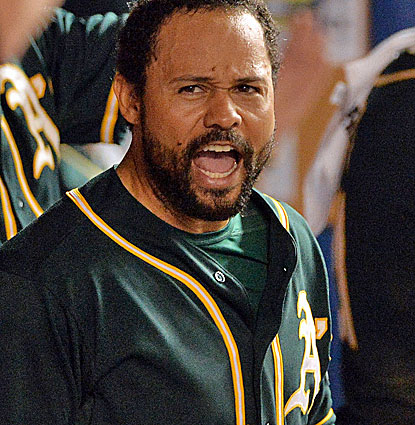 Oakland's Coco Crisp scores the go-ahead run in the ninth inning on a replay reversal. (USATSI)