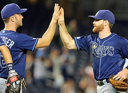 Game hero Logan Forsythe (right) and the Rays celebrate a late rally to complete the comeback in the Bronx. (USATSI)