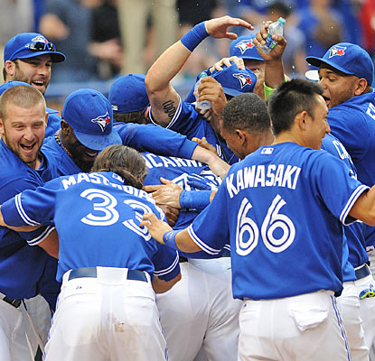 Edwin Encarnacion is at the middle of the celebration for the first-place Blue Jays.  (USATSI)