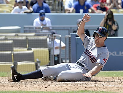 David Murphy slides home with what turns out to be the winning run in Cleveland's eighth-inning rally.  (USATSI)