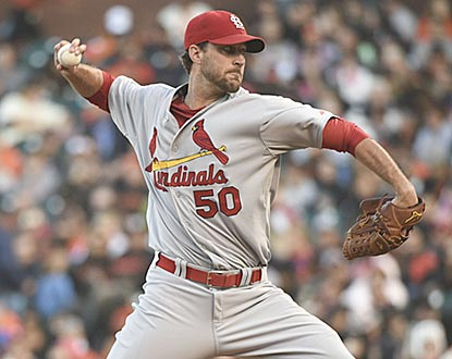 With his seventh scoreless start of 2014, Adam Wainwright takes over the NL lead in ERA (1.89).  (USATSI)