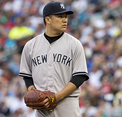 Rookie sensation Masahiro Tanaka rolls along to his Major League-best 12th win of the season. (USATSI)
