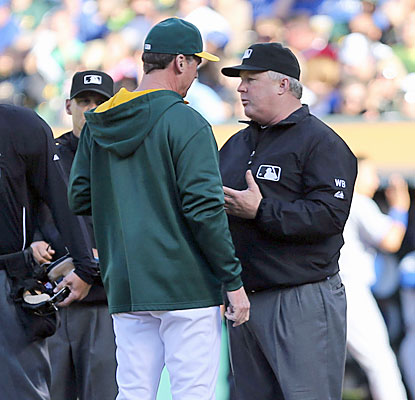 A's manager Bob Melvin argues an overturned call after the Jays request a review on a double play in the second. (USATSI)