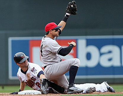 Brian Roberts, who gets four hits and scores two runs for the Yankees, lays the tag on Brian Dozier for an out. (USATSI)