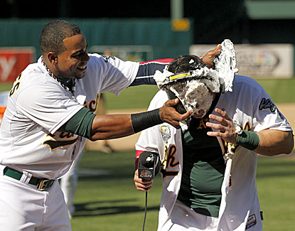 Oakland's Nick Punto gets the shaving cream treatment from Yoenis Cespedes after Punto's winning double in the 12th. (USATSI)