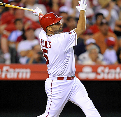 Albert Pujols connects for one of the Angels' three home runs during an eight-run 7th inning.  (USATSI)