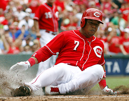 Reds shortstop Ramon Santiago slides into home plate but is called out due to fan interference in  the second inning. (USATSI)