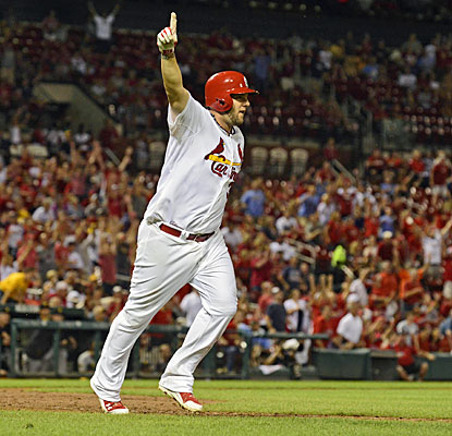 Matt Adams comes up with two of the Cards' three hits, including a walk-off home run in the ninth inning. (USATSI)