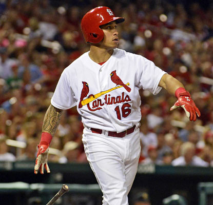 Kolten Wong strikes his walk-off home run pose, something the Cardinals have had practice in against the Pirates.  (USATSI)