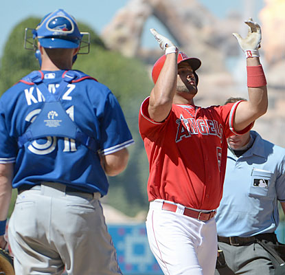 Albert Pujols delivers a go-ahead, two-run home run in the seventh after the Jays took the lead an inning earlier. (USATSI)