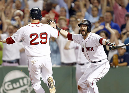 Dustin Pedroia (right) waits as Daniel Nava, who represents the winning run, crosses the plate in the ninth. (USATSI)