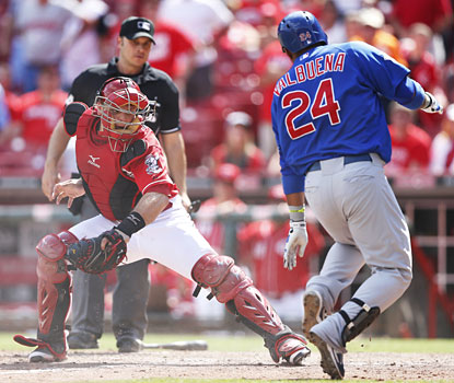 Luis Valbuena is out at the plate in the 12th inning, but not before the go-ahead runs score for the Cubs.  (Getty Images)