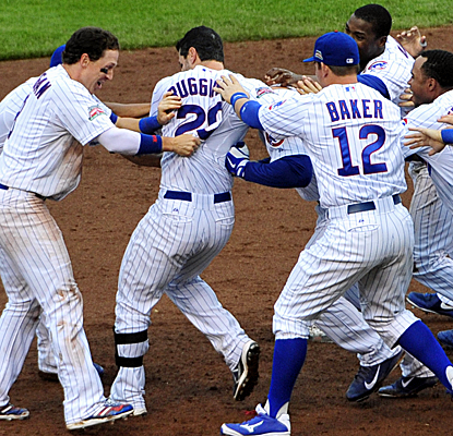 Justin Ruggiano is mobbed by his teammates after his walk-off single lifts the Cubs over the Braves.  (USATSI)