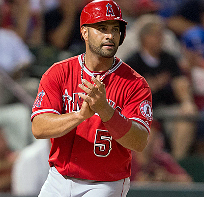 Albert Pujols and the Angels send the Rangers to their sixth consecutive loss to gain a game on Oakland.  (USATSI)