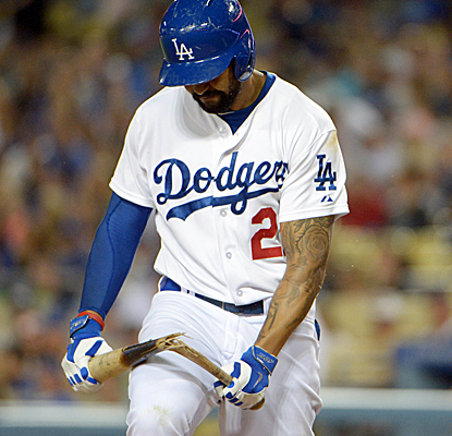 Matt Kemp shows his frustration after striking out as the Dodgers fall at home to the Padres.  (USATSI)
