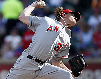Jered Weaver (10-6) goes seven innings for the Angels, giving up two runs and four hits against the Rangers. (USATSI)
